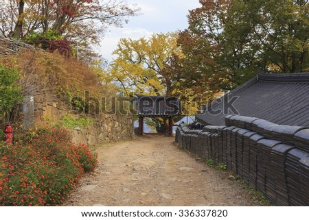 Korean traditional buildings and road in the Sujongsa temple at the fall(autumn).