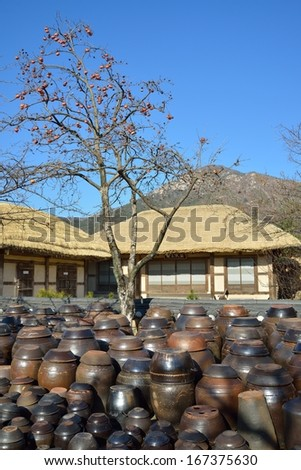 Korean Traditional platform for crocks of sauces and condiments - stock photo