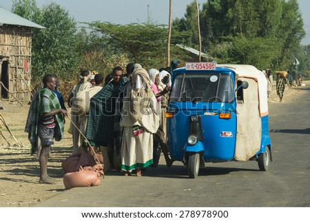 Korem, Ethiopia - January 19, 2012: Group of unidentified people in traditional but poor clothings waiting for a rickshaw ride on the road to Korem, near Lalibela, Ethiopia.