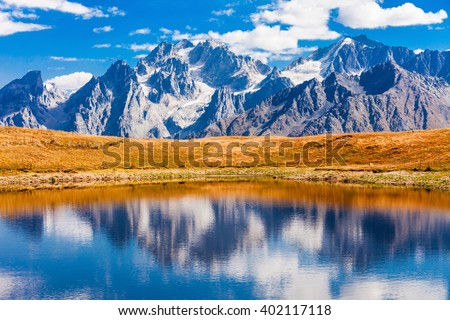 Koruldi Lake at the foot of Greater Caucasus range in Upper Svaneti region, Georgia - stock photo