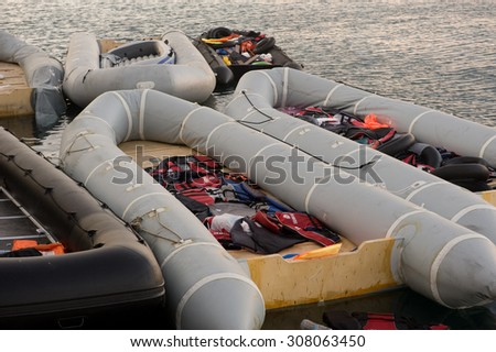 Kos, Greece - August 14, 2015: Greece-Europe-Migrants. Empty rubby boats with 		life jackets at the port of Kos in Greece.