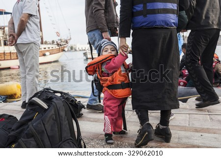 Kos, Greece - October 17, 2015: Mother with her child after arrival to the port of Kos town, on the Kos island, Greece.