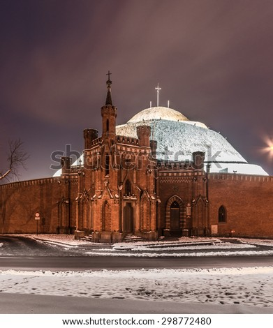 Kosciuszko mound surrounded by old fortifications in Krakow, Poland, during winter night