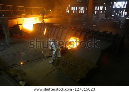 KOSICE - APRIL 22:  Workers at  U.S. Steel Kosice, s.r.o., work around a blast furnace producing steel in Kosice, Slovakia, on April 22, 2005.