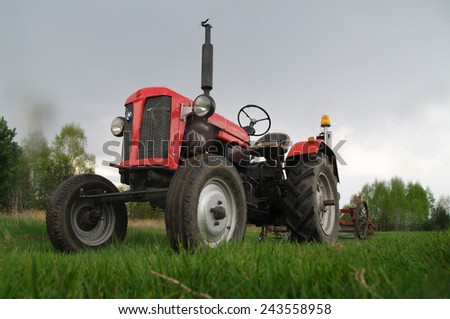 KOSMIDRY, POLAND - July 01, 2014 Old tractor in the field  - stock photo