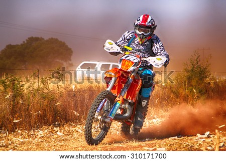 KOSTER, SOUTH AFRICA - July 11:  Africa-Offroad Racing Rally,  on July 11, 2015 at Koster, North West Province, South Africa.  HD - Motorbike kicking up trail of dust on sand track during rally race.