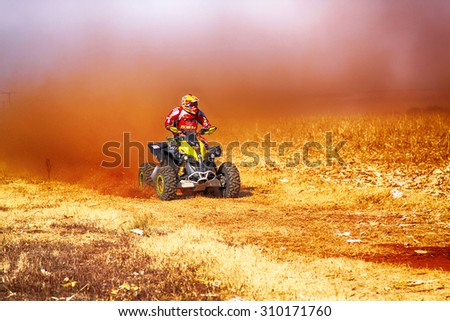 KOSTER, SOUTH AFRICA - July 11:  Africa-Offroad Racing Rally,  on July 11, 2015 at Koster, North West Province, South Africa.  hd Quad Bike kicking up trail of dust on sand track during rally race. - stock photo
