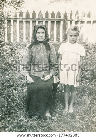 KOSTOPIL,UKRAINE, CIRCA 1955 - Vintage photo of grandmother with granddaughter