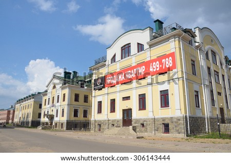 "Kostroma, Russia, August, 10, 2013. Under construction residential complex ""Romanovsky"" on  the embankment of Volga river"