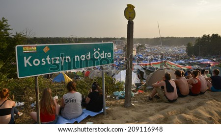 KOSTRZYN NAD ODRA, POLAND - AUGUST 2, 2014:  Festival Przystanek Woodstock - view of the people at the camping and festival area. It is the biggest open music festival in Europe. - stock photo