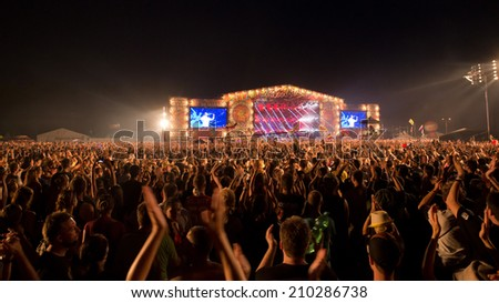 KOSTRZYN NAD ODRA, POLAND - AUGUST 2, 2014: Funs during concert Coma at the Festival Przystanek Woodstock. Przystanek Woodstock is the biggest open music festival in Europe. - stock photo