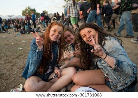 Kostrzyn Nad Odra, Poland. 30th JULY, 2015. Smiling fans of 21 Festival Przystanek Woodstock - it is the biggest open music festival in Europe.