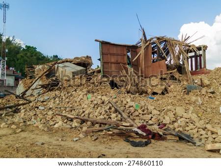 KOT DANDA, LALITPUR, NEPAL - MAY 2, 2015: Damaged houses after the 7.8 earthquake that hit Nepal on April 25, 2015. - stock photo