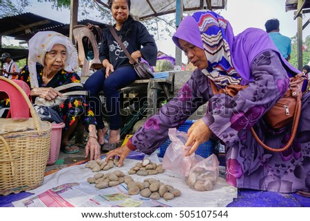 Kota Belud, Sabah Malaysia - Jan 18, 2015 : Villager selling agriculture product at a local market called Tamu. The Tamu tradition started more than 100 years ago to as business and meeting place.