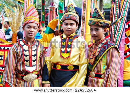 Kota Belud, Sabah, Malaysia, Okt 18, 2014 : Youngster from the Bajau and Iranun ethnic wearing their traditional costume and headdress for  the 4th Usunan Festival competition in Kota Belud. - stock photo