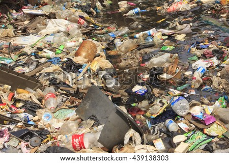 KOTA KINABALU, MALAYSIA - 05 JUNE 2016: Pollution environmental problem. Plastic bags and bottles and sewerage dumped directly into ocean due to lack of sanitation and refuse collection services.