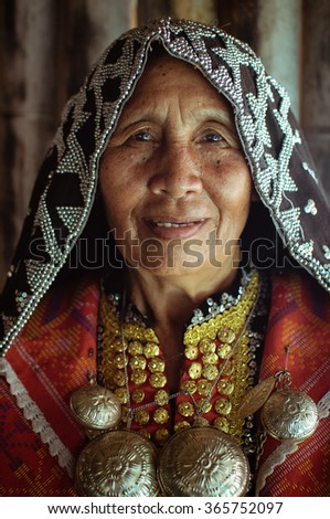 "Kota Kinabalu, Malaysia - May 31, 2013: Dusun Lotud Lady Wearing Native Costume during Harvest Festival which is known as ""Pesta Kaamatan"" among locals."
