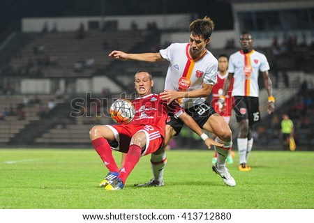 Kota Kinabalu Sabah Malaysia - Apr 8, 2016 : Sabah player Marco Tulio Silva (red) try to win the ball over KL Sime Darby FC, Ha Dae Won during Malaysia Premier League match at Likas Stadium. - stock photo
