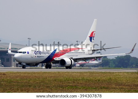 Kota Kinabalu Sabah Malaysia-March 14,2016 -Malaysia Airlines Boeing 737-800 is started landed at Kota Kinabalu International Airport.Photo taken during daylight, typical aviation background.  - stock photo