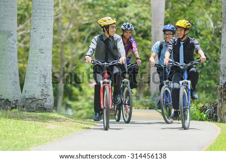 Kota Kinabalu Sabah Malaysia - Sep 11, 2014:A group of unidentified university student cycling to attend class.Most university in Malaysia encourge student to opt cycling in their campus activity. - stock photo