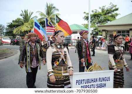 Kota Kinabalu Sabah Malaysia – 31st  August 2017 : A group of malaysians wearing rungus traditional costumes during the celebration of 60th National Day at Kota Kinabalu, Sabah.Malaysia.