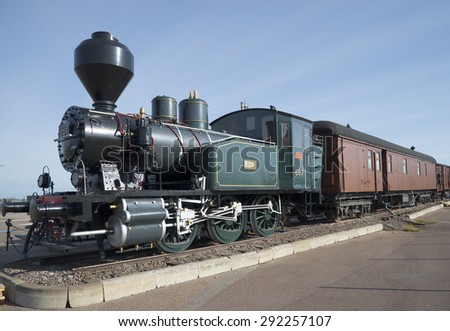 KOTKA, FINLAND - AUGUST 17, 2013: Old locomotive with wagons in the Maritime centre of Valamo