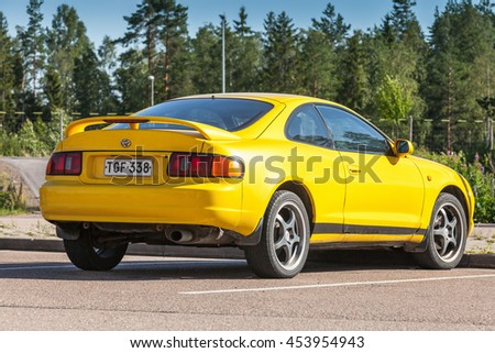 Kotka, Finland - July 16, 2016: Bright Yellow Facelift Toyota Celica GT liftback T200 model of 1994-1999, rear view