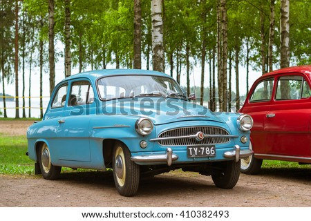 KOTKA, FINLAND - JUNE 14, 2014: Skoda Felicia coupe cars parked on shore of Finnish gulf. Festival and exhibition of retro-club of the Czech automaker. Island Mussalo, Kotka, Southern Finland, Suomi