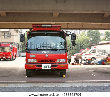 KOTO, TOKYO - JUNE 4, 2014:	Fire Engine of the Tokyo Fire Department. They provides fire protection to the capital area of Japan.