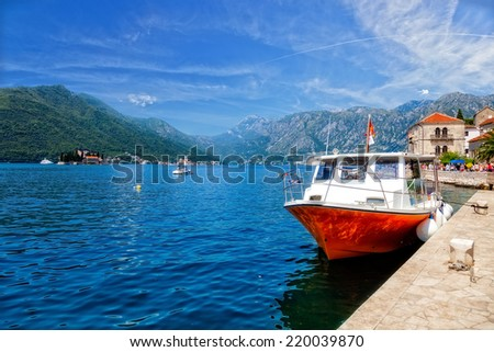 Kotor bay (Boka Kotorska) with pier and boats in Perast, Montenegro.