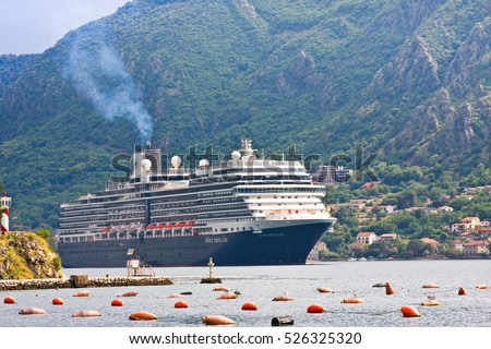 KOTOR, MONTENEGRO - JUNE 24, 2015:Cruise ship in the port of Kotor in cloudy day. Montenegro. Kotor is very popular travel destination of Europe
