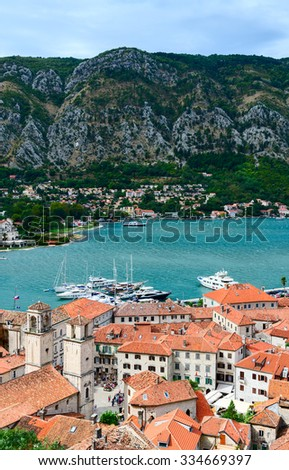 KOTOR, MONTENEGRO - SEPTEMBER 21, 2015: Top view of the Old town and the ships in the Bay of Kotor, Montenegro