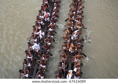 KOTTAYAM, INDIA - AUGUST 29 : Snake boat teams in the Kottayam Boat race on August 29, 2010 in Kottayam, India. - stock photo