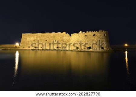 Koules (Castello del Molo) at night,  in the port of Iraklion - stock photo