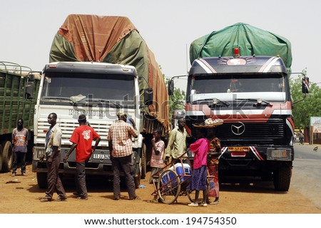KOUPELA, BURKINA FASO - FABRUARY 25: A Koupela African hub for road transport across all African countries, the departure of trucks loaded with goods., fabruary 25, 2007. - stock photo