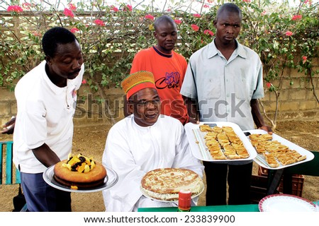 KOUPELA, BURKINA FASO - FEBRUARY 25: Food Arrangement to the village chief for a party in Honor of his enthronement at the head of the village, february 25, 2007. - stock photo