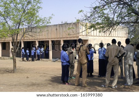KOUPELA, BURKINA FASO - FEBRUARY 20 : The pupils of the college Saint-Philippe are in recreation and benefits from it to find themselves and speak together, February 20, 2007 - stock photo
