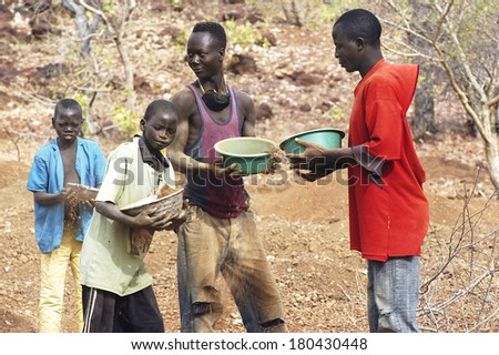 KOUPELA, BURKINA FASO - JANUARY 10: wild golden Koupela mine, the gold diggers come from everywhere to dig, hoping to find fortune and work in poor conditions for little gold, january 10, 2008. - stock photo