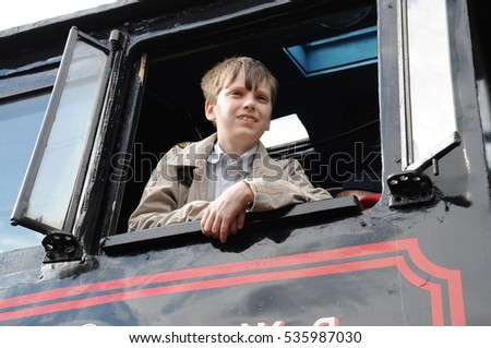 KOVROV, RUSSIA - MAY 2, 2015: Victory Train arrived at the railway station of the city of Kovrov. Boy in the cockpit of the Victory Train locomotive