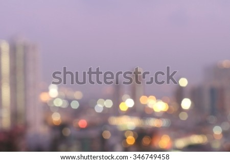 Kowloon taken from a high angle. After sunset a panoramic view of the city boundaries.Bokeh blurred golden city City specializes in the marketing and trading. The prosperity of the city and modernity. - stock photo