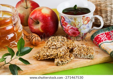 kozinaki sunflower seeds tasty food apples and honey in a still life with a tea party - stock photo