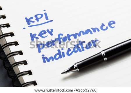 KPI and Key Performance Indicator text as memo on notebook