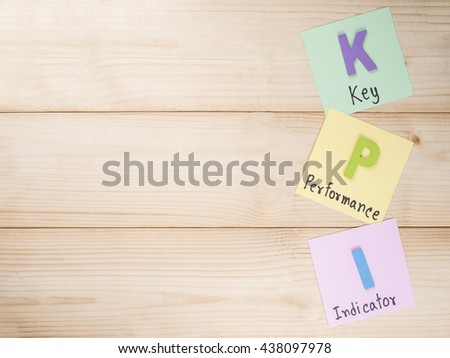 KPI (Key Performance Indicator) on notepaper with wood background (Business concept) - stock photo