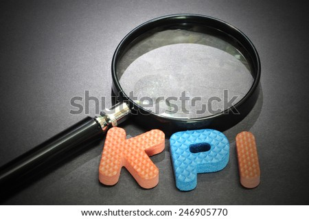 KPI (Key Performance Indicator )words with magnifying glass - stock photo