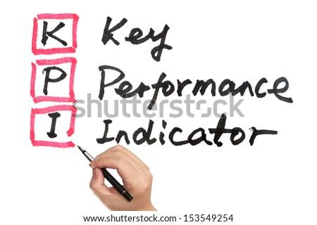 KPI - Key performance indicator words written on white board - stock photo