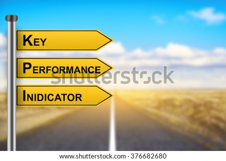 KPI or Key Performance Indicator words on yellow road sign with blurred background - stock photo