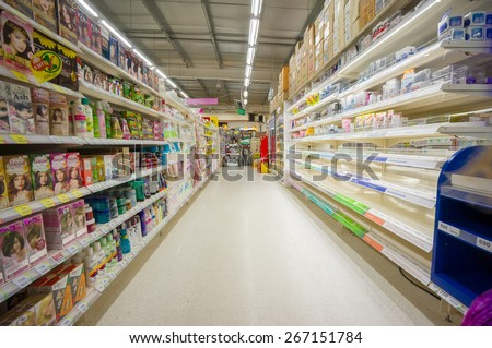 Krabi, 20 january 2015: Rows of shelves in Tesco Lotus supermarket in Krabi Muang district, Krabi province, Thailand.  Tesco Lotus is a largest hypermarket chain in Thailand.