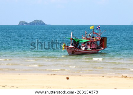 Krabi, Thailand-April 12th, 2015: thai traveller in asian wooden boat go to the beach in krabi thailand