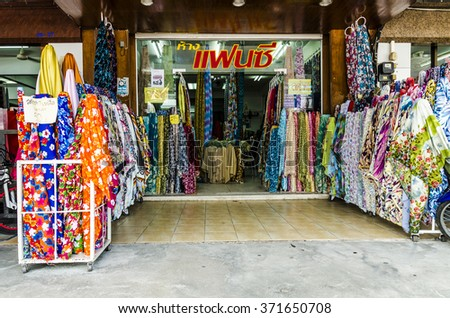 KRABI,THAILAND - FEBRUARY 11, 2013: Souvenir shops and cafes for tourists in the resort of Krabi in Thailand