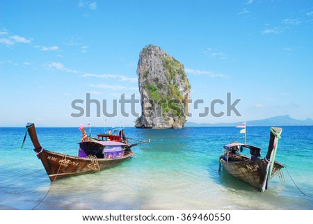 KRABI, THAILAND - January 20 : Unidentified holidaymakers relaxing on the beach on January 20, 2016 in Poda Island, Krabi, Thailand. Poda Island is one of famous island in Krabi.